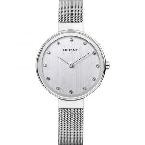 Bering - Classic dameur med urkasse i poleretrustfrit stål. Den grå urskive er udsmykket med små klare zirkonia. Uret har en klassisk smalmesh rem. 12034-000.