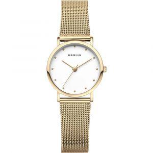 Bering - Classic ur med poleretguldfarvet urkasse irustfritstålog guldfarvet mesh rem. Det har enklassiskhvid urskive, beskyttet afridsefast safirglas. 13426-334.