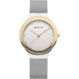 Bering - Classic dameur i mat stål, og stål med en guldfarvet poleret overflade. Uret har ridsefast safirglas og en moderne mesh rem. 12934-010.