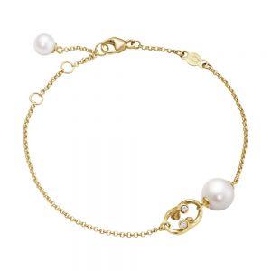 Georg Jensen - Magic armbånd i 18 karat guld. Det elegante armbånd er udsmykket med enkeltehvideferskvandsperler og diamanter. 10009350.