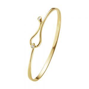 Georg Jensen - Magic armring i 18 karat guld med diamanter. Den elegante armring erdesignet af Regitze Overgaard. Omkreds: S: 16 cm. M: 16,5 cm. L: 17 cm. 20000130000.